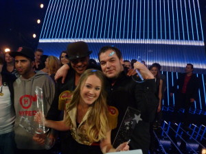 Soluna Samay with her songwriters on stage after winning Dansk Melodi Grand Prix